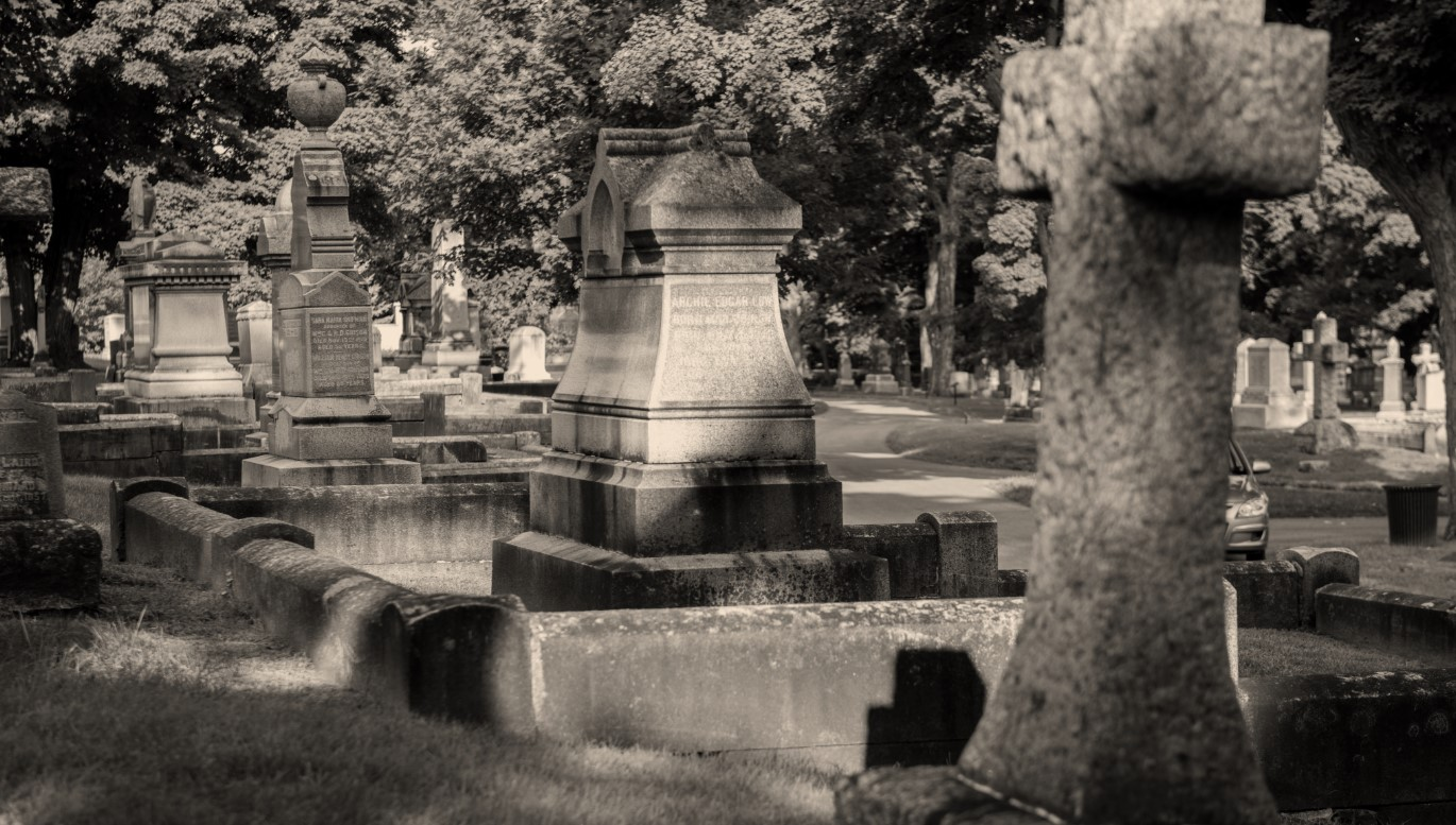 Black and white picture of older section of cemetery